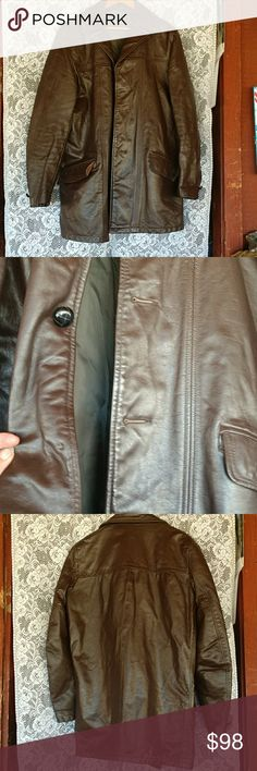 """Vintage Mens long leather jacket Really nice long leather coat from my husband's closet. Unfortunately the size and brand tag are missing as well as two buttons and the liner. I found the care tag that says to ship it directly to R. Sherman Leather Cleaners in New Jersey! Jack has a few marks some are shown in the photos but in really good condition overall. I will try to post measurements shortly ( have to go help hubby real quick) but I took a few pics of me wearing it I am close to 5'9""""…"""
