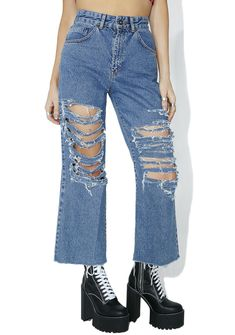 The Ragged Priest Slater Jeans what's another rip in tha knees to you anyways? These sikk high waisted jeans feature a classic light blue denim construction, wide leg cut, frayed hems, tons 'N tons of shredded sh!t down the legs, and zipper fly 'N button closure.