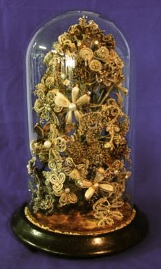 As described on the blog: Bouquet of hair worked flowers under glass display dome, New Zealand, 1896.