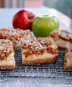 Apple Crisp Cheesecake Bars - brown sugar shortbread, vanilla bean cheesecake, and cinnamon apples all tucked under a blanket of crisp topping! | ButtercreamBlondie.com