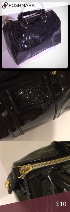 Victoria's Secret patent satchel black Victoria's Secret patent satchel black. Front says supermodel, back is plain black. Super shiny, golden color hardware. Pair it with the BCBGeneration cute heels I have listed also! Victoria's Secret Bags Satchels