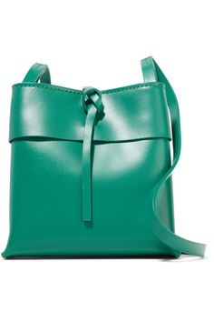 Jade leather (Cow) Tie fastening at open top Comes with dust bag Weighs approximately 0.7lbs/ 0.3kg Imported