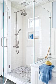 This light-filled shower enclosure boasts a marble bench—faced to look 4 inches thick—and marble pebble tile for a daily foot massage.   Photo: David Fenton   thisoldhouse.com