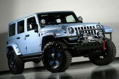 Lifted 2013 Jeep Wrangler Unlimited 4 Inch Pro-Comp Lift Kevlar Coated