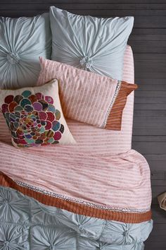 Anthropologie's bedding makes me feel all giddy. If only I could afford it. This bed is calling my name.