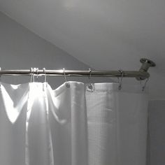 This shower is designed for a sloped ceiling. The kit extends the curtain around to help prevent overspray on the bathroom floor. One rod is included that can be trimmed down on site to fit. Bathroom Colors, Bathroom Shower Curtains, Bathroom Sets, Bathroom Flooring, Small Bathroom, Ceiling Curtain Rod, Corner Curtain Rod, Corner Curtains, Shower Rods