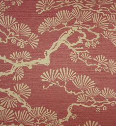 Keros Vinyl Wallpaper A block print inspired vinyl wallpaper featuring a stylised pine tree design in gold on a red background.