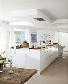 vintage table - modern kitchen. similar floor and units. We need a very rustic table to break down the harsh modern lines