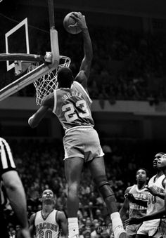 """""""UNC's Michael Jordan soars over the rim for a dunk in action against Wake Forest in the Tar Heels' 1982 season."""""""