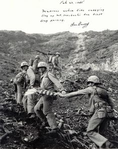 Marines carrying the first flag up Iwo Jima. SO COOL!