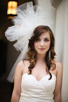 Love her hair and the giant bow! I probably wouldn't do that big a bow, but it's so fun!