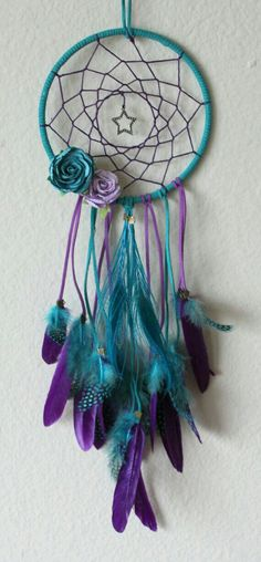 Aqua and Purple Star & Peacock Feather Dream Catcher with Paper Flowers and… Los Dreamcatchers, Feather Dream Catcher, Purple Dream Catcher, Peacock Feathers, Peacock Colors, Goose Feathers, Beautiful Dream Catchers, Diy And Crafts, Arts And Crafts