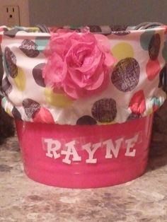 Thirty-one cinch sac used as a liner in a dollar tree bin.  Perfect for Easter basket, baby shower gift or decor.