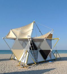 """Y-BIO, by Archinoma is a temporary, modular colony providing instant shelter and connection with nature. The Y-BIO unit is designed according to the """"Sierpinski pyramid"""" mathematical model, and is created by attaching three chains to three vertexes of three tetrahedrons strung up so that they're levitating slightly above the ground. The entire thing is held together using structural steel tubing."""