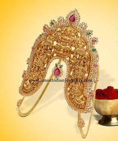 Heavy designer gold vanki in Pancha Lakshmi design encrusted with uncut chakri diamonds, rubies and emeralds.