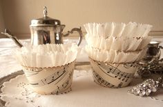 Just a Note. Twelve Antique Sheet Music Cupcake Wrappers with Shimmering Ruffles. $20.00, via Etsy.
