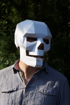 UK-based designer Steve Wintercroft has designed a wonderful polygonal skull mask that can be crafted out of cardboard. He is selling plans and instructions on his Etsy store.