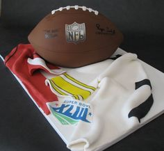 Football cake for a super bowl party. Football is hand carved, with fondant jerseys.