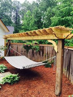 The wooden pergola is a good solution to add beauty to your garden. If you are not ready to spend thousands of dollars for building a cozy pergola then you may devise new strategies of trying out something different so that you can re Backyard Hammock, Diy Hammock, Backyard Retreat, Hammock Stand, Backyard Patio, Backyard Landscaping, Hammocks, Outdoor Hammock, Patio Hammock Ideas