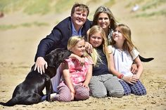 Queen Maxima and King Willem-Alexander, with Princess Amalia and Princess Alexia and Princess Ariane with dog Skipper pose for the media during the annual summer photo session on the beach near Meijendel in Wassenaar on July 10, 2015.