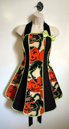 Vintage inspired Pumpkin Party stylist / kitchen apron by XO Skeleton Creations - Alexander Henry fabric. $50.00, via Etsy.