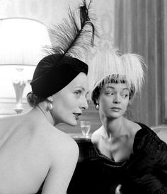 Tête-à-tête, Lucille Lewis and Jean Patchett wearing feathered hats by Sally Victor, photo by Nina Leen, 1948