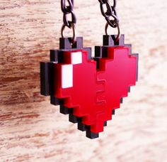8-bit Heart Necklace ... I hate heart jewelry usually but i think I could make an exception for this :)
