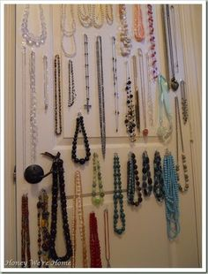 Command hooks to hang jewelry on the inside of closet door