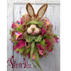 Bunny Wreath tutorial - video and written, supplies at Trendy Tree!  http://www.trendytree.com/blog/diy-bunny-wreath/