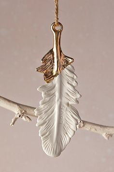 Gold-Flecked Feather Ornament - anthropologie.com