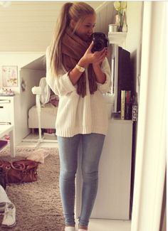 Skinny jeans, loose rolled sleeved sweater, chunky watch and chunky scarf