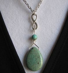 INFINITY TEAR DROP by MimiJewels on Etsy, $22.00.  http://www.etsy.com/listing/119594898/infinity-tear-drop?ref=shop_home_active