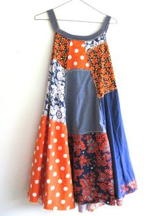 reserved for Tricia                                        sweet but funky little tunic / dress for playing in the city and then out to dinner - made from cotton, lace and jerey and pieced together in a funky kind of way that is very flattering to the body :) this piece is very raw and worn looking!    lots of funky in this little tunic / dress. you will love how it hangs and flows! * color palette - orange, denim, blue, off white and greens    *would look great with a pair of boots...