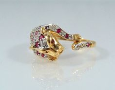 Peter Sellers' Pink Panther revisited!  This is an attention-getting ludic piece of jewelry!  Wrap your finger with this unique animal motif ring set in #18K bright yellow a... #18k #gold #stamped #jewelry #estate