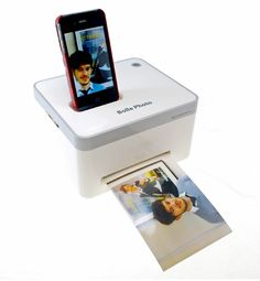 Get instant gratification with the  iPhone Photo Printer. Talk about simple. With just the click of one button, Mom can print out her iPhone pictures with this tissue box-sized printer.