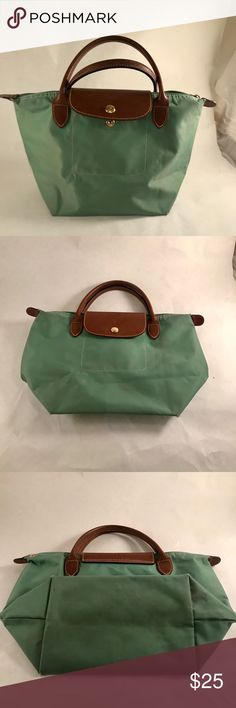 Small Green Longchamp Bag Small, green and compact-able longchamp. The perfect size for an everyday throw around purse. It has some wear as shown but is still sturdy and beautiful. Longchamp Bags Totes