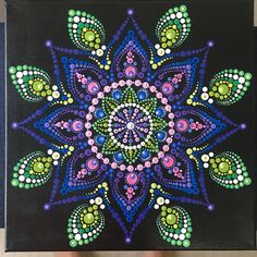 Original dot mandala painting on 12 x 12 canvas. Beautiful pink, purple, and green colors, reminiscent of a delphinium flower. Some iridescent colors used. Sealed with acrylic sealer and signed on the back.