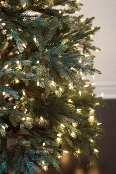 A ribbon is the perfect solution to concealing those bare spots in your Christmas tree while also adding a touch of color and texture. Live Christmas Trees, Hanging Christmas Lights, Unique Christmas Trees, Alternative Christmas Tree, Xmas Tree, Christmas Urns, Cozy Christmas, Outdoor Christmas, Christmas Christmas
