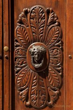 Antique Door Knocker With Bronze Mask Of Bacchus In Montalcino.