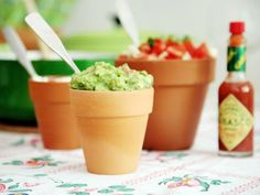 Serve all your dips in terra-cotta pots in varying sizes, saving you money on serveware. You can use the smaller pots for food and fill larger ones with flowers as table centerpieces.