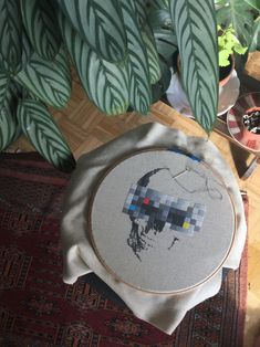 A very detailed design of a human skull with pixelated eyes. 8 shades of grey make the skull look very realistic. Color codes for DMC and ANCHOR are included in the pattern! The design is stitched 2 over on 18 count FLOBA from Zweigart. Modern Cross Stitch Patterns, Cross Stitch Designs, Spooky Halloween Decorations, Color Codes, Human Skull, Stitch 2, Fiber Art, Fabric Design, Hand Embroidery