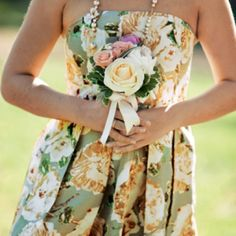 Beautiful floral bridesmaids dress with flower bouquet
