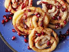 Fried Pastries with Wine Syrup : Hanukkah celebrates all kinds of fried foods, not just latkes. These fried pastries with a hint of orange are drizzled with a fragrant cinnamon wine syrup and topped with crunchy pomegranate seeds.