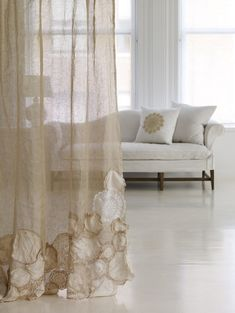 Use old doilies and scraps of lace to dress up a curtain panel. Inspiration.