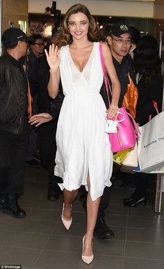 Miranda Kerr in white dress then changes into pink number in Hong Kong