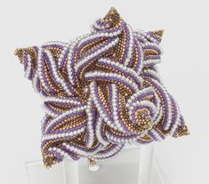 Chelsea's Cube , a twisted star tetrahedron by Pamm Horbit of White Lotus Beading
