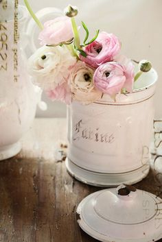 ranunculus in a french enamel canister