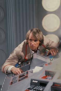 The Fifth Doctor (Peter Davidson) in the TARDIS in 1984.
