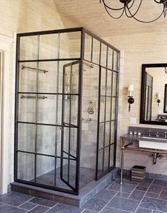 really loooove this glass shower doors and grey tiled floors. bathroom designed by Jeffrey Bilhuber