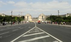 Looking from the Pont d'Iena bridge towards the Palais Chaillot while standing near to the Eiffel Tower, showing the building in the background with its terrace in view.  You may be interested in more; www.eutouring.com